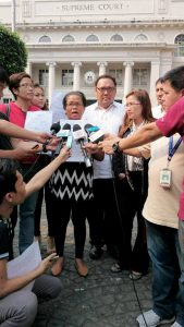 Harry Roque and the family of the murdered victim at the Philippine Supreme Court