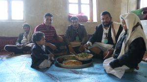 Fahd's three brothers (centre) and two nephews having a meal at the Ghazy home in 2013