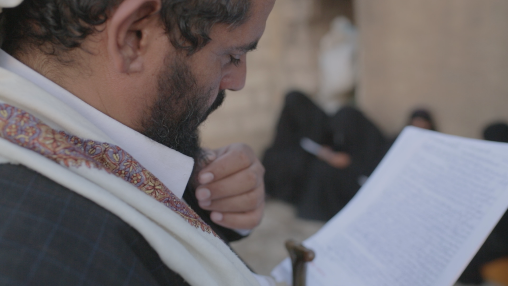 Mohammed Ghazy, Fahd's older brother, at the Ghazy home in 2013, reading a letter Fahd sent from Guantanamo