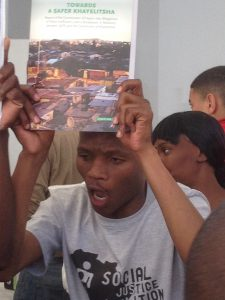 Khayelitsha residents celebrate at the release of the Commission report on 25 August 2014, picture: SJC