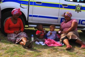 Khayelitsha residents take a break outside the Commission's public hearings, picture: Shae Herrmann