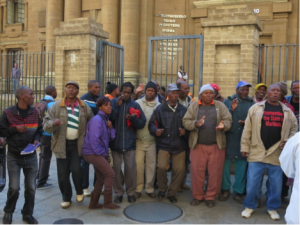 Vaal community members gather outside the High Court in Johannesburg