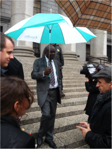 BAI Managing Attorney, Mario Joseph, descends the courthouse stairs after the October 23,2014 oral arguments in the case before the federal court in the Southern District of New York. Photo courtesy of Kim Ives.