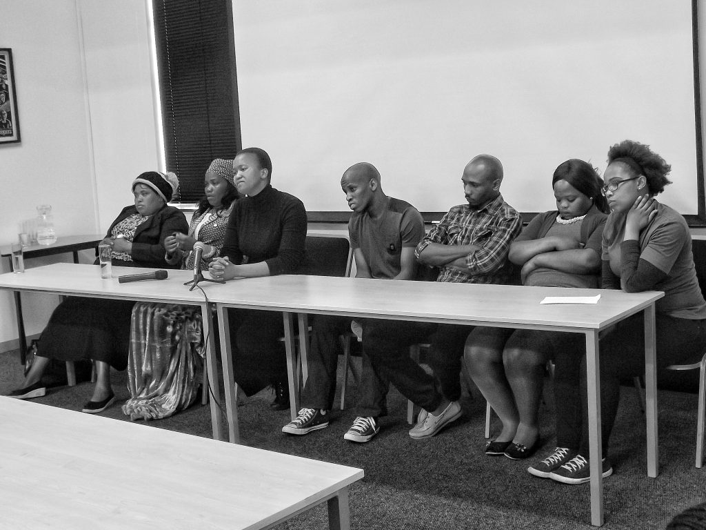 "Widows and children of the deceased miners fielding questions from the media at the launch of ""Imbokodo: The Widows of Marikana"". Credit: Zwonaka Netshifulani"
