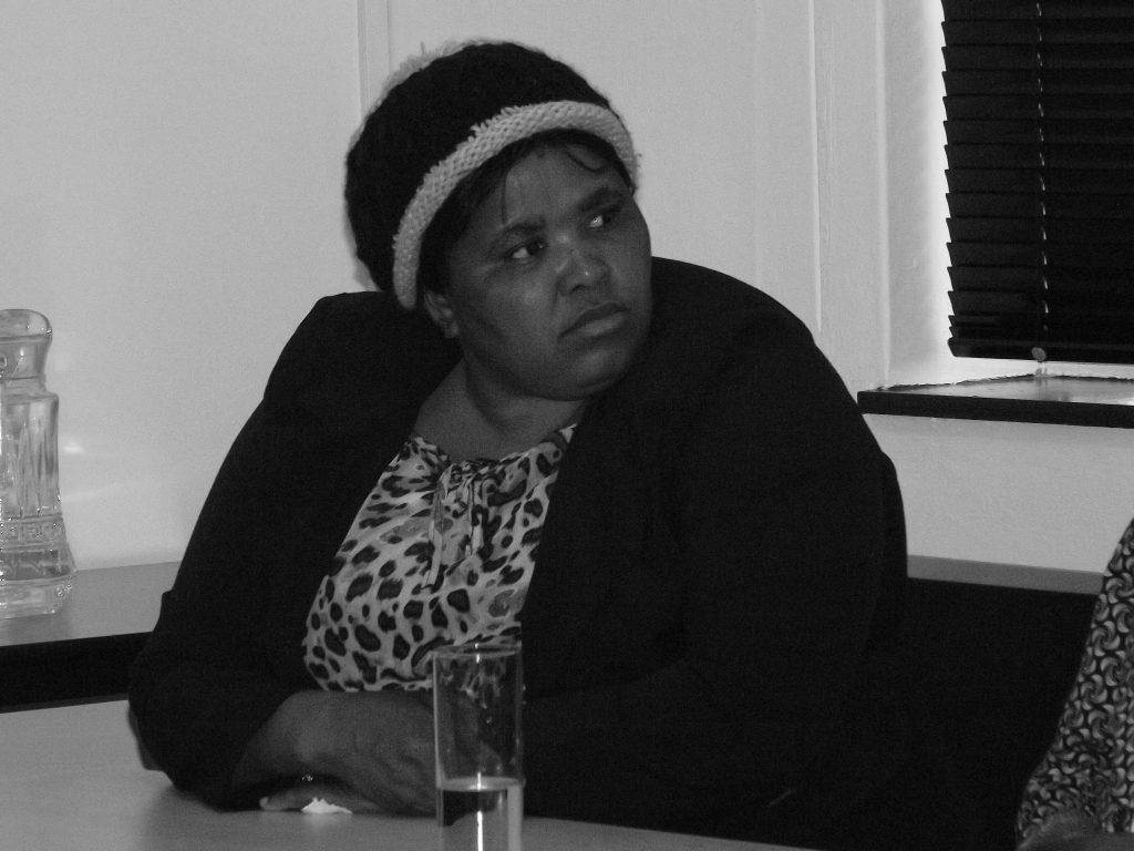 Zameka Nungu, widow of Jackson Lehupa, one of the miners killed at Marikana, listening to the panel at the launch. Credit: Zwonaka Netshifulani