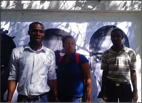 BAI Bertha Fellows Jhimmy Surin, Gladys Thermezi and Ronald Chataigne pose after installing photos at UN logbase