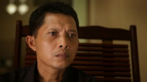 Adi, an optometrist who seeks to confront the death squad leaders responsible for his brother's death during the 1965 Indonesian genocides in Drafthouse Films' and Participant Media's The Look of Silence. Courtesy of Drafthouse Films and Participant Media.