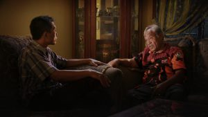 Adi questions Commander Amir Siahaan, one of the death squad leaders responsible for his brother's death during the Indonesian genocide, in Joshua Oppenheimer's documentary The Look of Silence. Courtesy of Drafthouse Films and Participant Media.