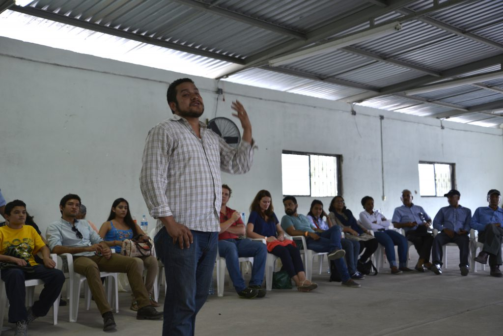 A community member speaks to educational exchange participants in Mexico